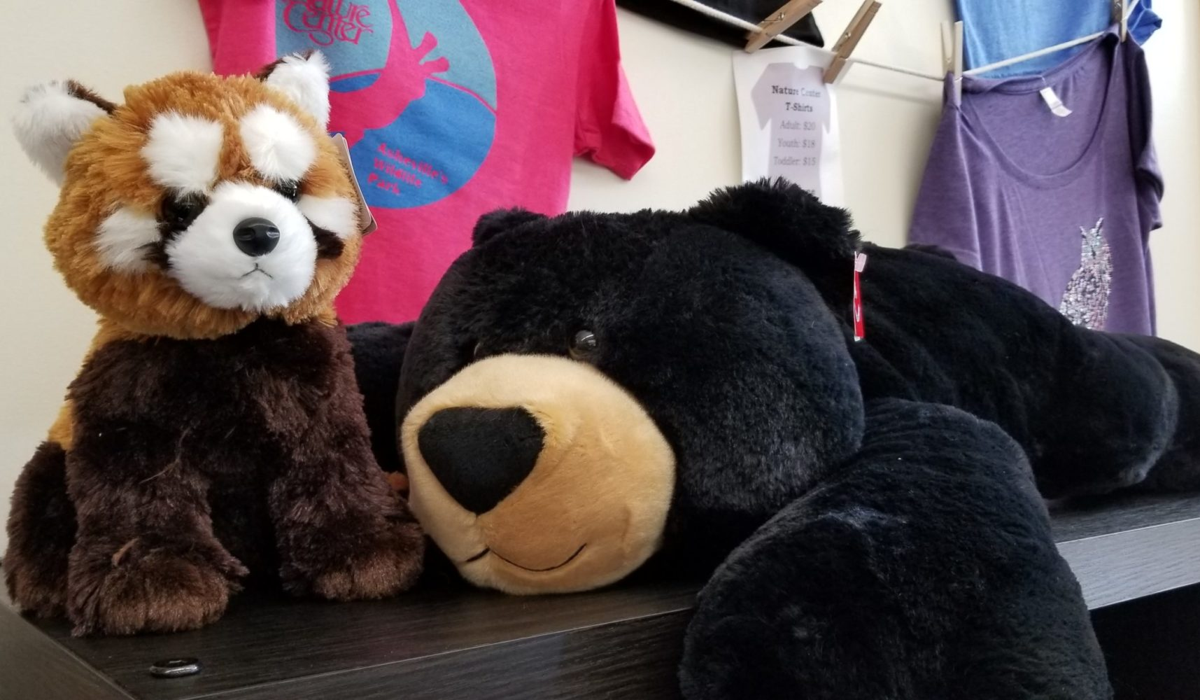 Plush animals and tshirts in the Nature Center Gift Shop
