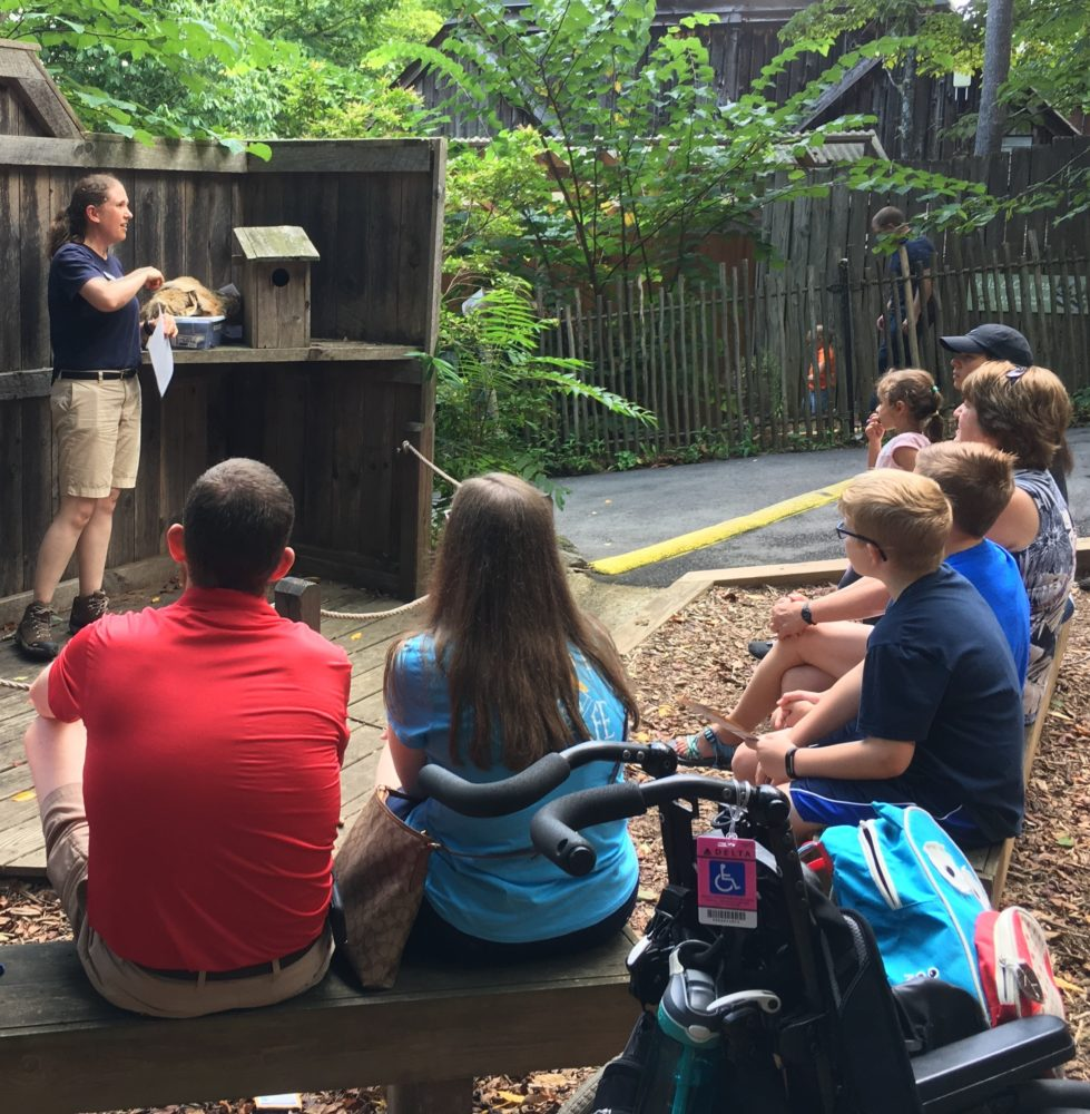A Nature Center intern speaks during an Animal Education program.