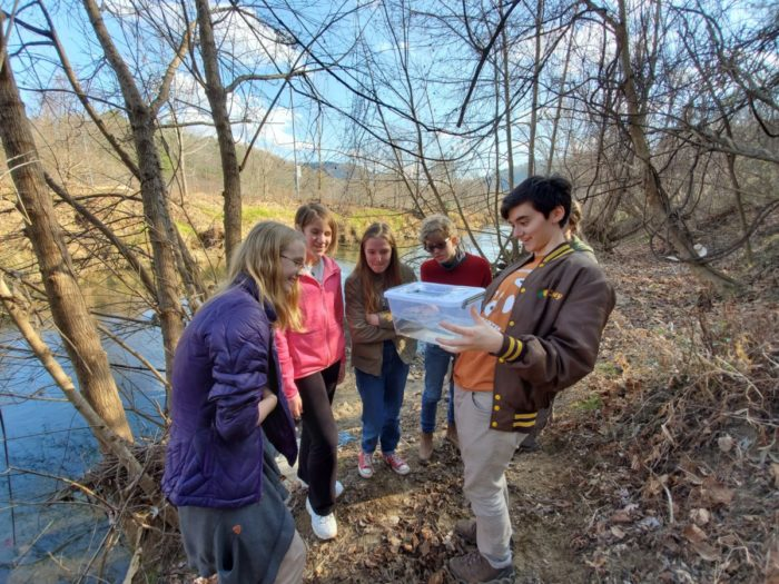 Young Naturalists look at river specimens.