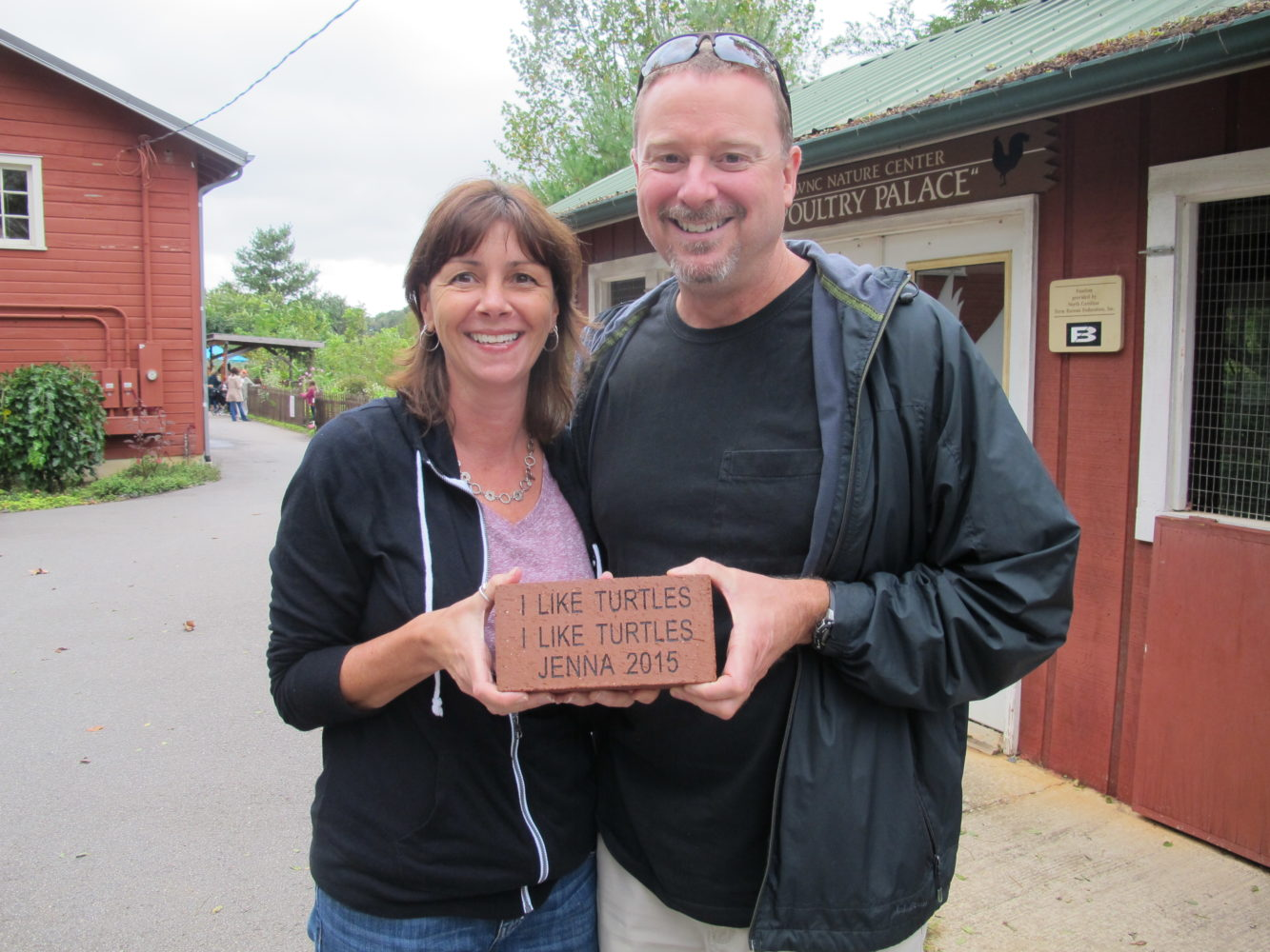 Couple holding an inscribed brick