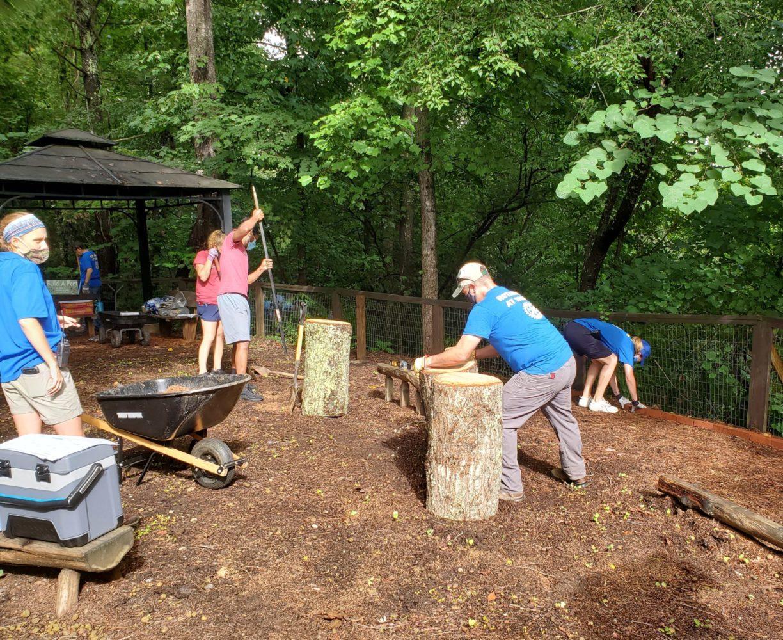 Volunteers work on Nature Play space.